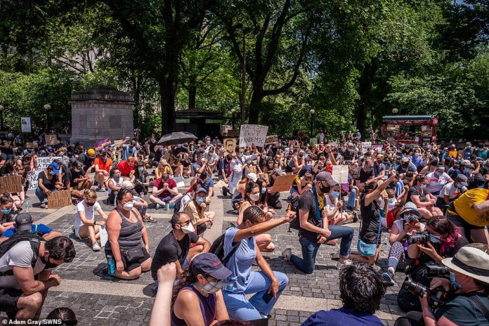 MANHATTAN, NEW YORK CITY: The demonstration was organized by Frontline4Change and medical personnel were seen kneeling, many dressed in scrubs.