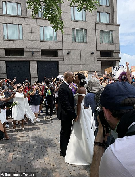 The couple received strong cheers from other protesters as they joined