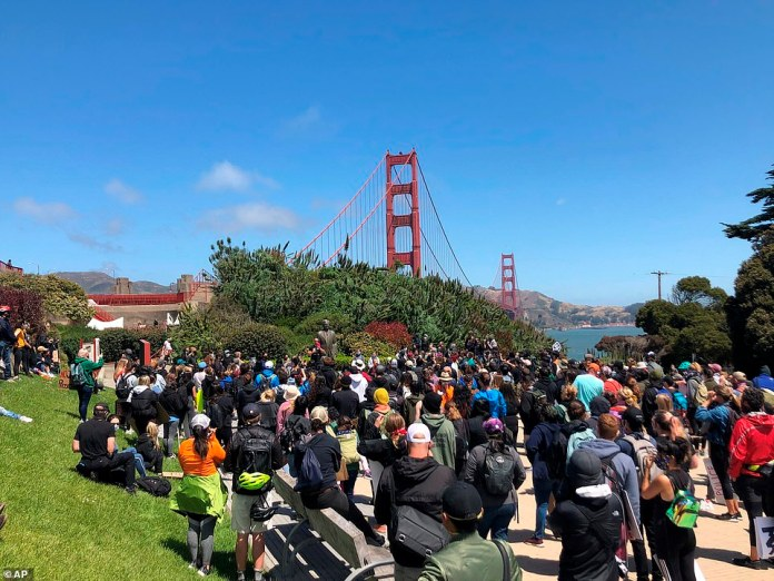 SAN, FRANCISCO, CALIFORNIA: Dozens of people gather by the Golden Gate Bridge in San Francisco to protest