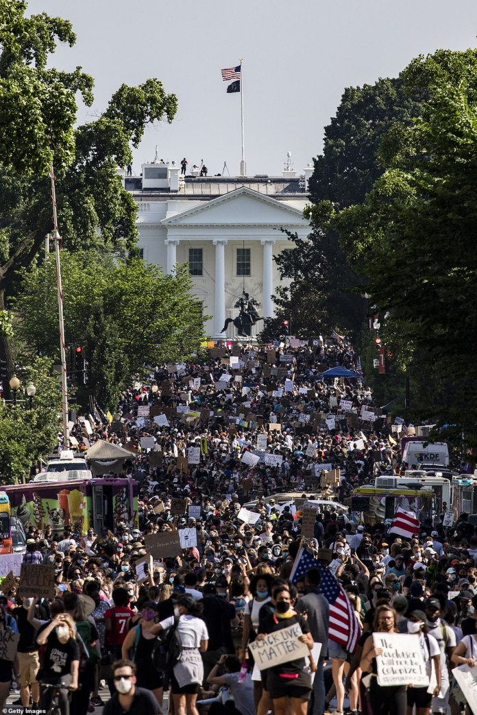 Thousands of protesters stretch over five blocks from Scott Circle NW to H Street NW