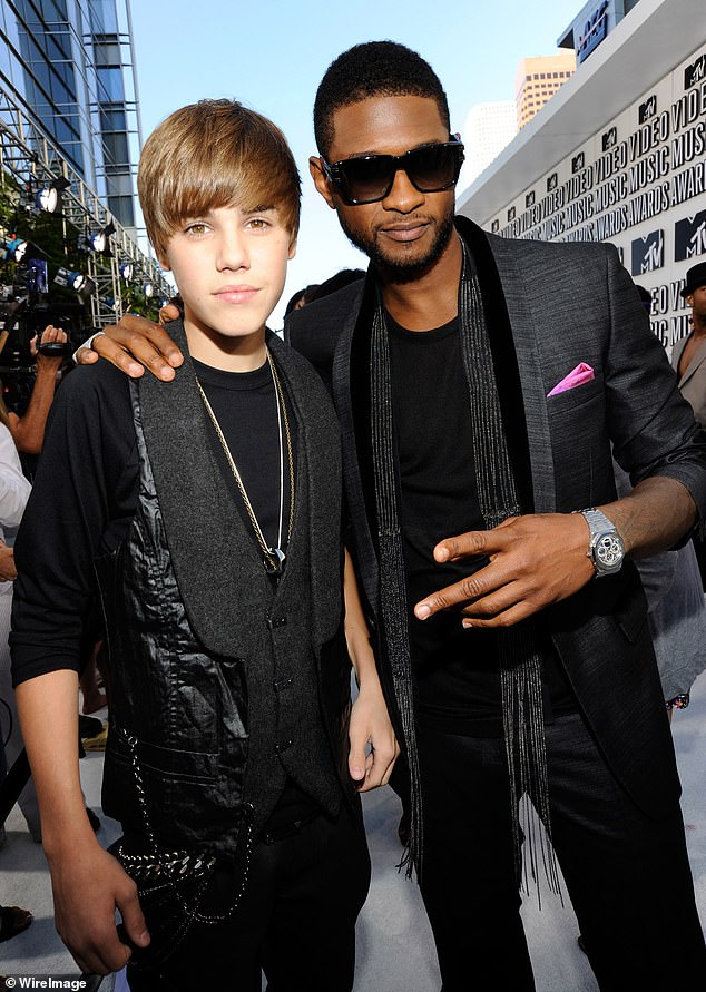 Mentor: Justin's biggest inspiration and mentor - and one of the people involved in launching his career - is fellow R&B star Usher, who happens to be African American; Usher and Justin photographed in 2010