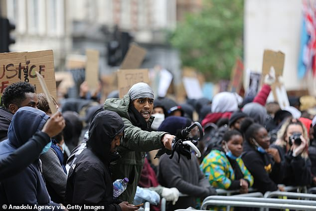 Protesters photographed outside Downing Street, London, during a Black Lives Matter demonstration