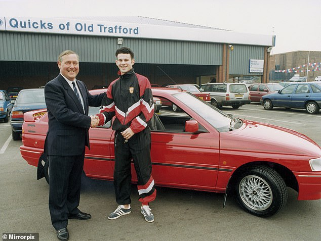 Giggs, pictured accepting keys to his new Jim Quick car for his birthday in 1991
