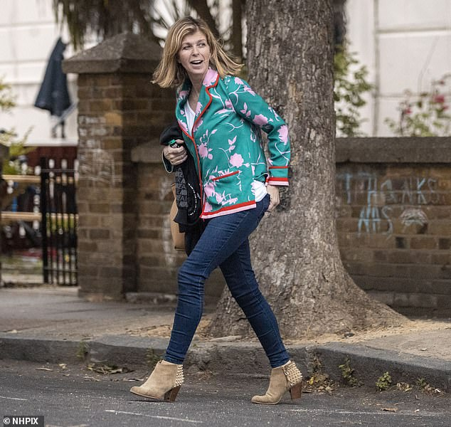 Staying positive: Kate Garraway showed courage when she left her London home with her ten-year-old son Billy on Tuesday evening