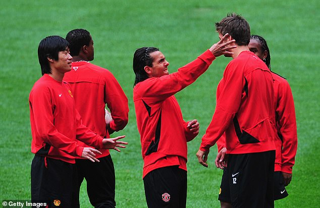 Carlos Tevez (center) playfully plays teammate Gerard Pique's ear during the training session at Luzhniki Stadium the day before the final, while Park Ji-sung (left) watches