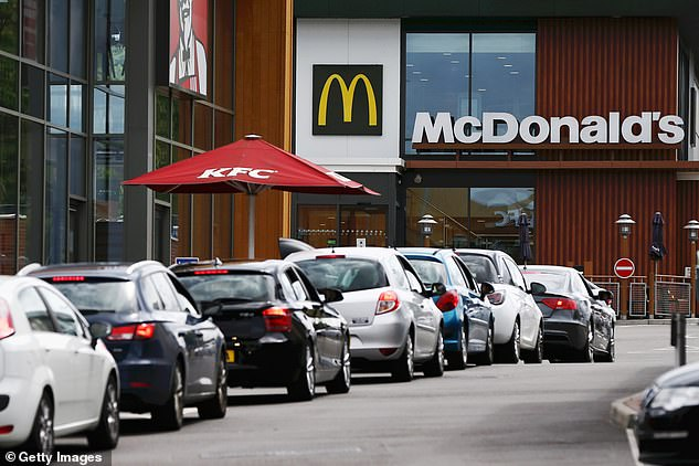 STOURBRIDGE: Cars queue to be served at a McDonald's Drive Thru in Stourbridge on June 4