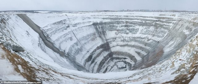 This enormous pit has been dug out since 1955 as the world's most productive diamond mine. At 525m (1,700ft) deep and 1200m (3,900ft) across, it is claimed as the second-largest man-made hole in the earth, writes David. Subterranean mining continues. A substantial new town extends right to the lip of the pit