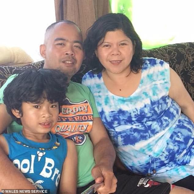 Mrs. David died the same day as theater assistant Allan Macalalad (photo with son Justin and wife Elsie), 48, of Cardiff, who also worked at University Hospital Llandough