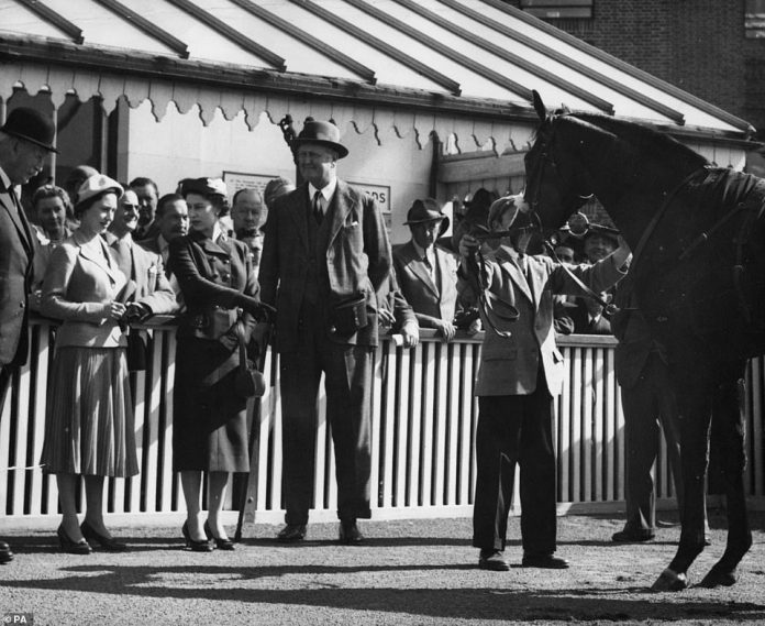 The royal shows him one of his favorite Doutelle horses after winning the 2,000 Guineas Trial Stakes at the Kempton Park races in 1957. The chestnut stallion was the queen's first first class horse in its own right