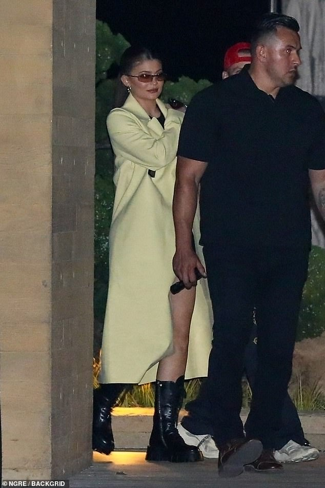 Rocking it:Kylie looked stylish as always as she wore a yellow designer duster coat along while leaving the celeb-favorite restaurant with her 27-year-old musician friend