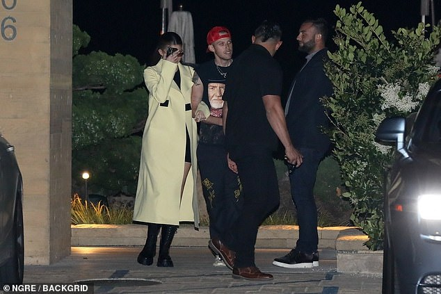 Vibes: Harry opted for comfort in a vintage Willy Nelson shirt with cut sleeves with sweatpants, Yeezy sneakers and a red cap on the back
