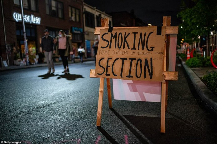 A sign indicates a smoking section in the