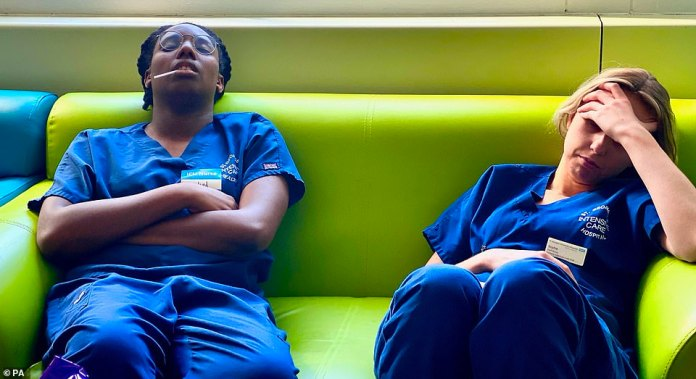 Jane Roe's 'Sleeping Colleagues Unmasked' shows two nurses, dressed in branded intensive care uniforms, asleep on a sofa after a tiring day on the front line