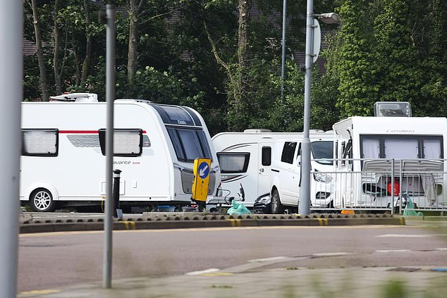A coronavirus testing centre in Watford has closed after a group of travellers set up camp