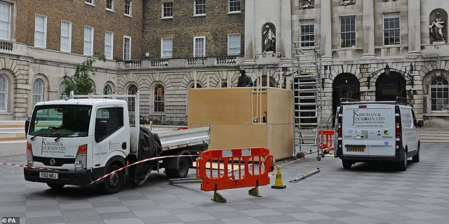 Workmen have this morning arrived at Guy's Hospital in London to begin boarding up a statue to its slave-trading founder Thomas Guy following pressure from Black Lives Matter protesters