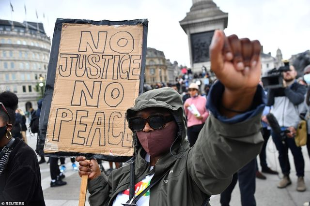 A demonstrator gestures during a Black Lives Matter protest in Trafalgar Square, following the death of George Floyd who died in police custody in Minneapolis