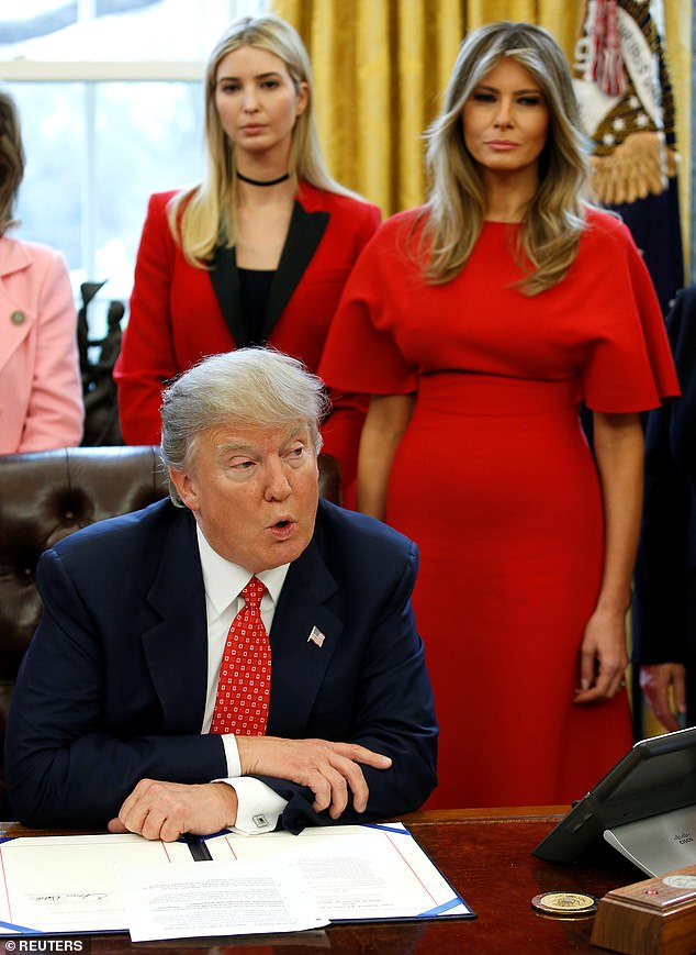 The new biography also reports on tensions between Melania Trump and Ivanka Trump, seen together in the Oval Office with President Trump in February 2017