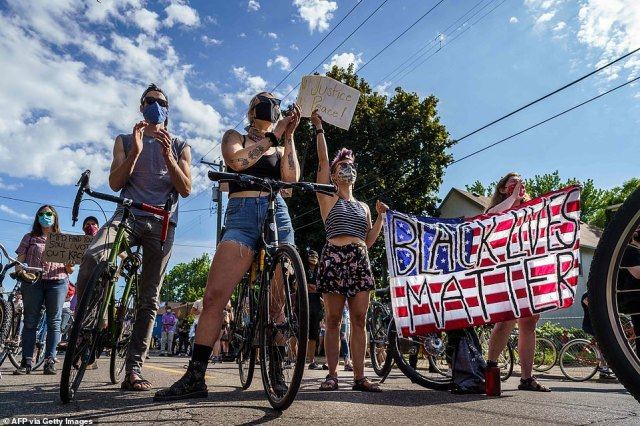 MINNEAPOLIS: Protesters hold American flag outside the Minneapolis Police and Fire Union Offices on Friday