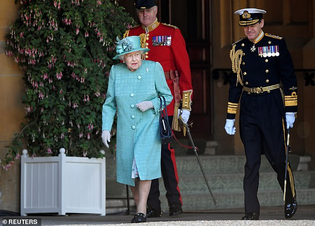 The Queen, 94, recycled a turquoise coat and matching hat to mark her official birthday at Windsor Castle on June 13