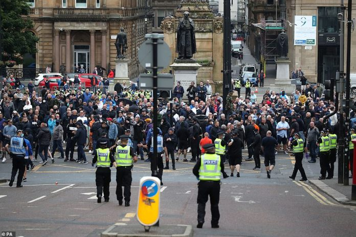 Police and members of the Loyalist Defense League in George Square in Glasgow as they