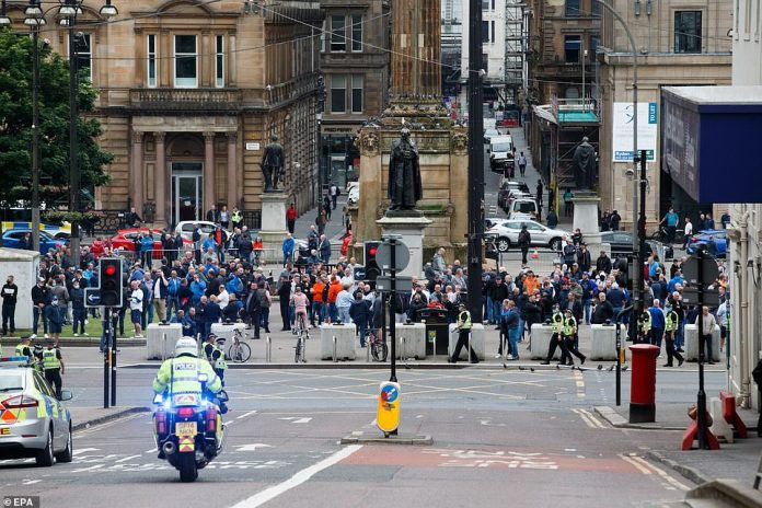 Missiles could be seen flying between the two groups as the police - with their batons drawn - formed a line across the street
