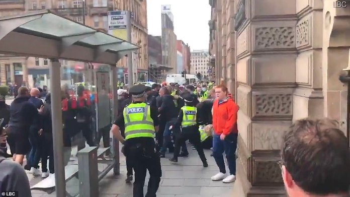 Ugly scenes saw the far right of the crowd on the ground a police officer in Glasgow who was helped to get back on his feet by their colleagues