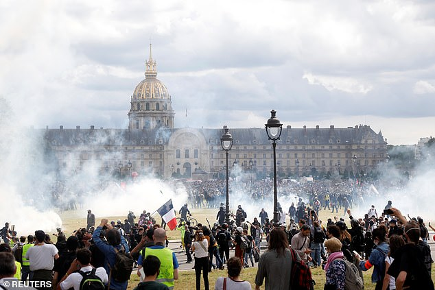 Hundreds of youths then made their way on to the large grass field in front of Les Invalides, where some of the worst fighting took place