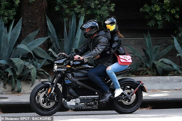 Ana's look: Affleck wore a black motorcycle helmet with the visor up, as well as a black leather jacket while riding in style