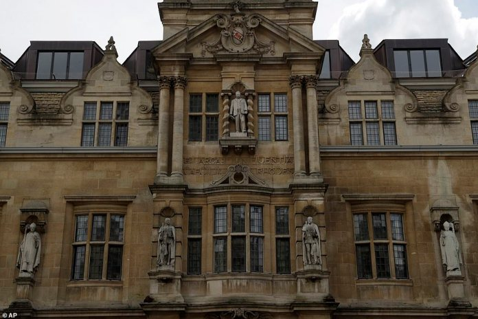 A statue of Cecil Rhodes, top center, the controversial Victorian imperialist, is mounted on the facade of Oriel College in Oxford