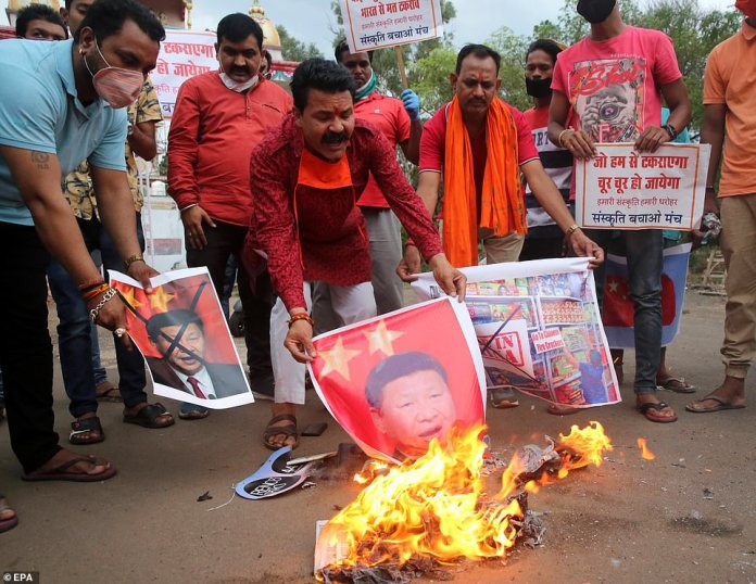 Indians burn images of Chinese President Xi Jinping in Bhopal on Tuesday after news of border violence