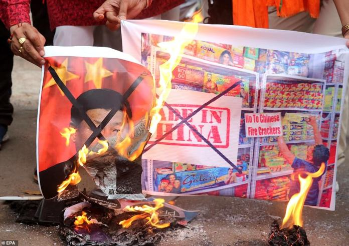 Activists from Sanskriti Bhchan Manch shout slogans as they organize a demonstration against China, holding posters of Chinese President Xi Jinping, in Bhopal, India, June 16