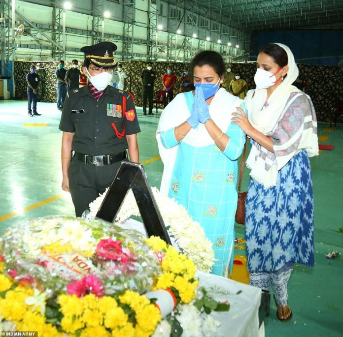 Family members pay tribute to the coffin of Colonel B Santosh Babu, the Indian commander killed after trying to appease the Chinese. Colonel Babu's mother, Manjula, told the New Indian Express,