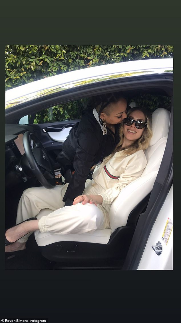 Car getaway: the pair demonstrated in love by posing for photos