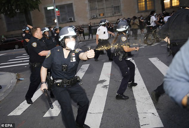 NYPD officers pepper spray protesters on May 30. Messages have been circulating among law enforcement officers in New York encouraging them to call out sick en masse on Independence Day