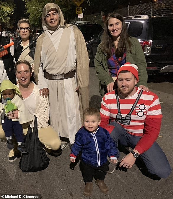 The two boys became best friends after their parents met in a New York restaurant and have been 'inseparable' ever since. The two families are pictured together here on Halloween