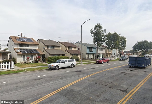 Henry Allen, 74, has been arrested on suspicion of murdering his wife Debbie, 63, at their home on this street in Long Beach, California. Her decomposing body was found inside