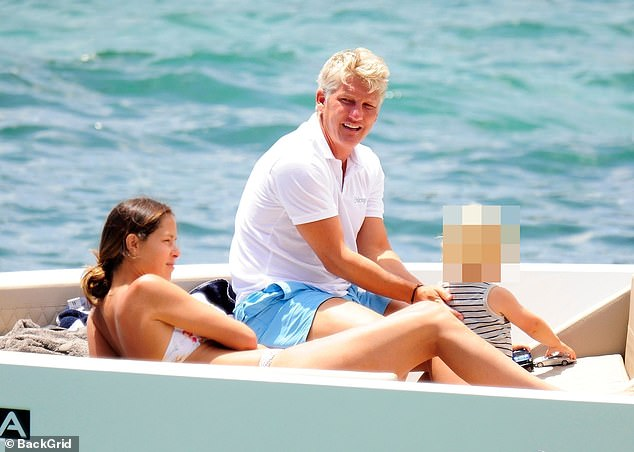 Mr and Mrs:Ana Ivanovic, 32, relaxed on a yacht in sunny Mallorca with her husband Bastian Schweinsteiger, 35, and their son on Thursday