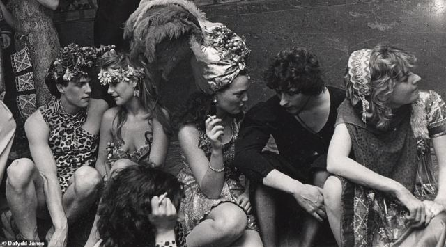 Animal magnetism: Hugh Grant, far left in leopard-print outfit, is pictured with friends including artist and milliner Marina Killery and designer Lulu Guinness at a ball in 1983