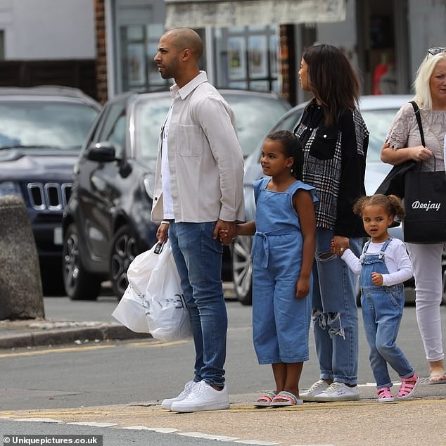 Family: Rochelle and Marvin Humes enjoyed a family filled Father's Day on Sunday as they took daughters Alaia-Mai, seven, and Valentina Raine, three on a trip to the shops in Essex