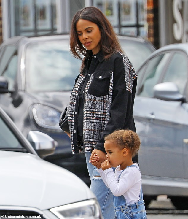 Gorgeous: The TV presenter, who is currently 23 weeks pregnant, looked radiant in ripped jeans and a black tweed jacket that gave a peek at her blossoming baby bump