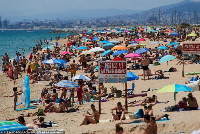 The first case of the new strain was detected in northern Spain on June 20, just one day before the country reopened its borders to EU tourists (pictured, people relax on a beach in northern spain on June 20)