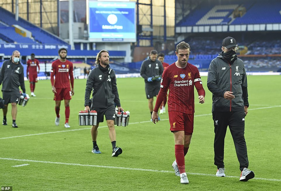 Klopp and Henderson walk off the pitch after the game, with Liverpool frustrated at being unable to take all three points