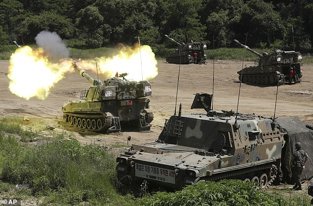 South Korean army's K-55 self-propelled howitzer tank fires during a military exercise in Paju, near the border with North Korea, today