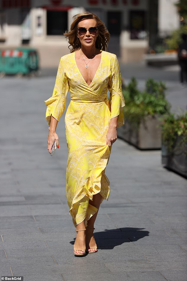 Sexy: Amanda went braless under the wrap dress as she prepares to go home