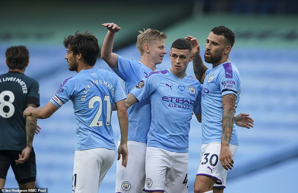 David Silva, Oleksandr Zinchenko and Nicolas Otamendi congratulate Phil Foden after he opened the scoring on Monday