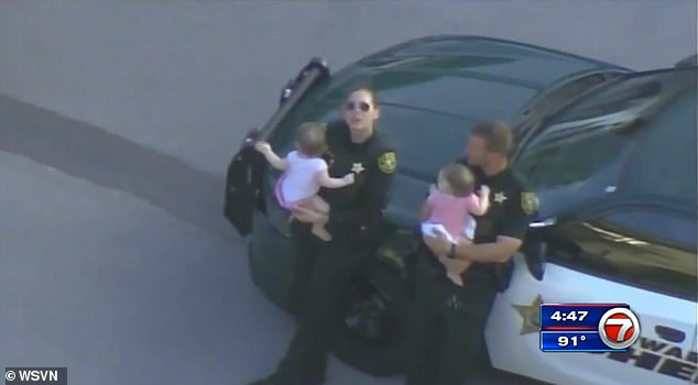 Police responding to a 911 call at a Florida condo complex found a woman who had been fatally shot and two pink-clad infant girls (pictured) inside the apartment
