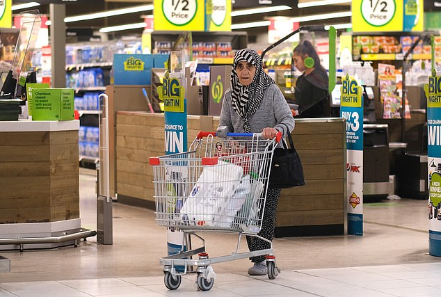 A woman leaves Woolworths Endeavour Hills Shopping Centre in Melbourne on Tuesday