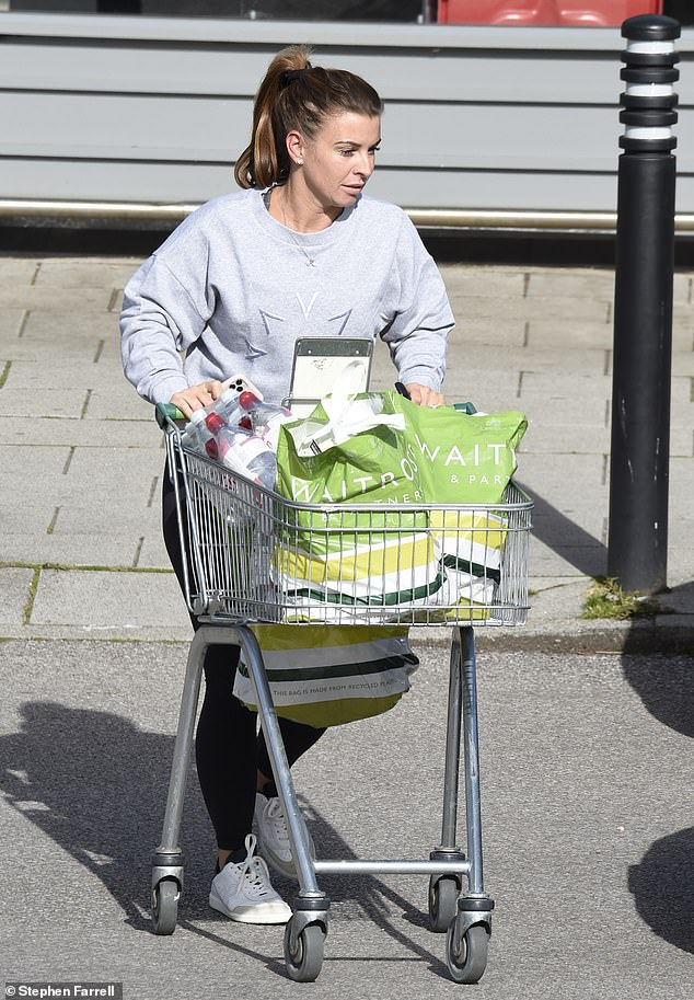 Stocking up:The WAG, 34, was spotted stocking up on her weekly groceries at her local Waitrose in Cheshire