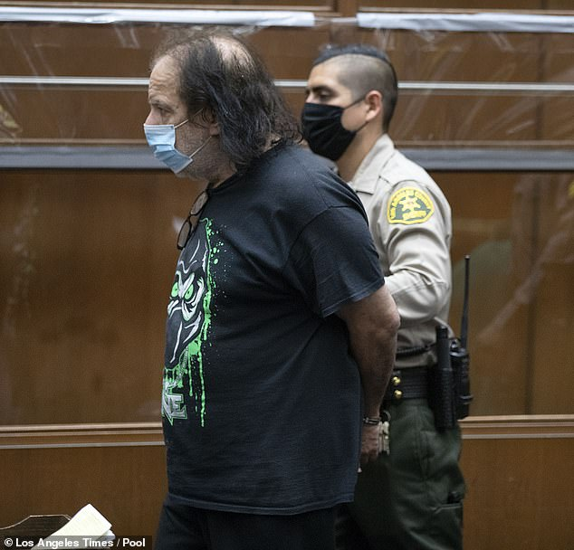Ron Jeremy is pictured being led by a guard in the Clara Shortridge Foltz Criminal Justice Center in Los Angeles during his arraignment