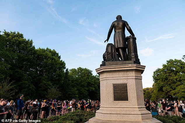 Protesters gathered at the Lincoln Emancipation Memorial on Tuesday night said that they would be returning with more support on Thursday to bring it down